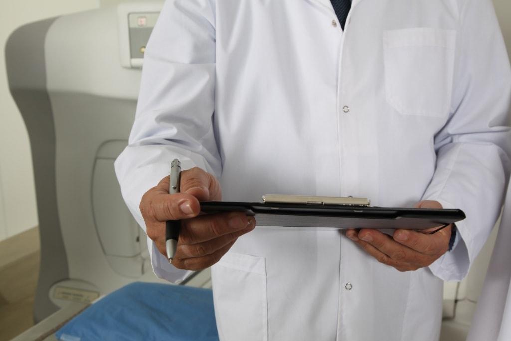 Doctor holding Pen